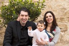 La famiglia felice, bambino dice ciao Fotografia Stock Libera da Diritti