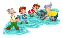 La famiglia sta facendo una piccola diga con le pietre. Fotografia Stock Libera da Diritti