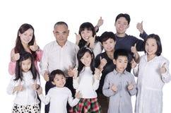 La familia multi de la generación manosea con los dedos para arriba Imagen de archivo