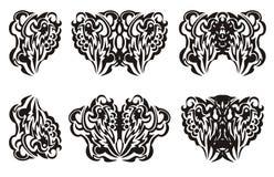 La farfalla tribale traversa il tatuaggio volando Fotografia Stock