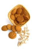 la farine d'avoine de biscuits de panier s'est renversée Photos stock