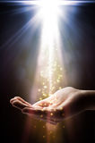 La fe cae en su mano Imágenes de archivo libres de regalías