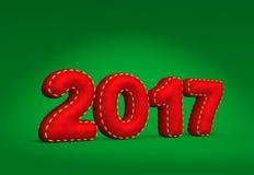 La fecha 2017 del Año Nuevo numera como almohada de tiro de la tela del terciopelo Imágenes de archivo libres de regalías