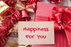 La felicidad para usted redacta en la caja del cuaderno y de regalo de la Navidad con d Fotos de archivo libres de regalías