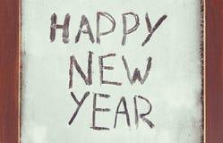 La Feliz Año Nuevo de la inscripción en la ventana escarchada Fotografía de archivo libre de regalías