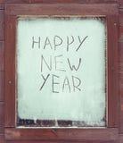 La Feliz Año Nuevo de la inscripción en la ventana escarchada Foto de archivo