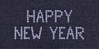 La FELIZ AÑO NUEVO del deseo se hace el color cristalino de los diamantes artificiales en un negro Fotos de archivo libres de regalías