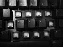 La Feliz Año Nuevo deletreó en llave de teclado negra Imagen de archivo