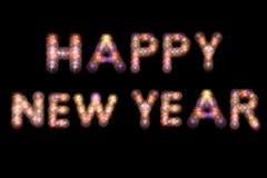 La Feliz Año Nuevo escribe con los fuegos artificiales Fotos de archivo