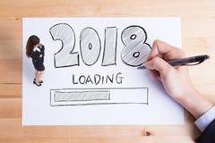La Feliz Año Nuevo está cargando Imagenes de archivo