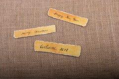 La Feliz Año Nuevo, Feliz Navidad, da la bienvenida a 2018 escrito el papel Fotos de archivo