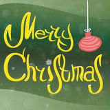 La Feliz Navidad de la inscripción, con la bola del ` s del Año Nuevo de los copos de nieve, de la nieve y del árbol de navidad Imágenes de archivo libres de regalías