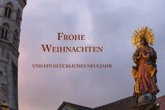 la Feliz Navidad de la tarjeta de felicitación y una Feliz Año Nuevo en alemán dejaron Foto de archivo