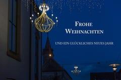 la Feliz Navidad de la tarjeta de felicitación y una Feliz Año Nuevo en alemán dejaron Imágenes de archivo libres de regalías