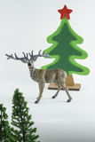 La Feliz Navidad y la Feliz Año Nuevo, la Feliz Navidad y la Feliz Año Nuevo, árbol de navidad simulan en fondo de la pizca foto de archivo