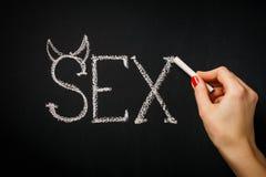 La femme écrit un sexe de mot Photo libre de droits