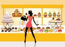 La femme achète des pâtisseries Photographie stock