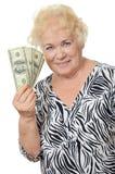 La femme agée avec des dollars Images libres de droits