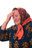 La femme agée touchant avec la main à la tête Photo libre de droits
