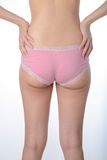 La femme asiatique lui montrent la graisse et des cellulites sur des fesses Photos libres de droits