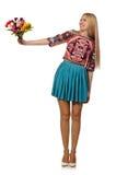 La femme avec des fleurs d'isolement sur le blanc Photographie stock libre de droits