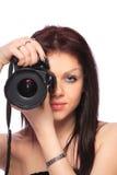La femme avec DSLR a isolé Photo libre de droits
