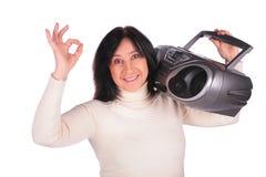 La femme avec la radio donne l'OK de geste Photos stock