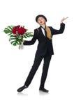 La femme avec le groupe de roses d'isolement sur le blanc Image stock