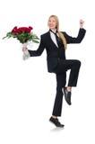 La femme avec le groupe de roses d'isolement sur le blanc Photographie stock libre de droits