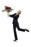 La femme avec le groupe de roses d'isolement sur le blanc Photographie stock
