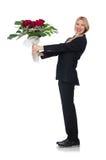 La femme avec le groupe de roses d'isolement sur le blanc Photos libres de droits