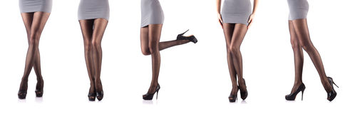La femme avec les jambes grandes d'isolement sur le blanc Images libres de droits