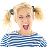 La femme avec un regard drôle sur son visage sourit Photographie stock libre de droits