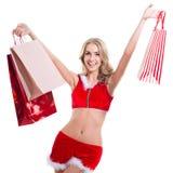 La femme beautyful heureuse dans le père noël rouge vêtx W Photos libres de droits