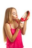 La femme d'achats aime des chaussures Image stock