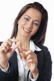 La femme d'affaires asiatique compare Photo stock
