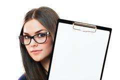 La femme d'affaires attire notre attention sur un espace de copie Images stock