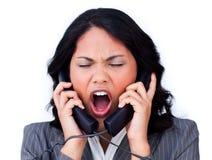 La femme d'affaires chargée a embrouillé vers le haut en fils de téléphone Image libre de droits