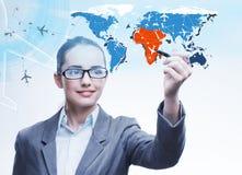 La femme d'affaires dans le concept de transport du monde Photographie stock libre de droits