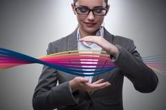 La femme d'affaires dans le concept médical avec de l'ADN conceptuelle Photos stock