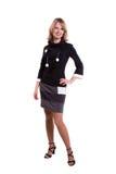 La femme d'affaires de Brunette a rectifié dans la robe noire. Photographie stock libre de droits