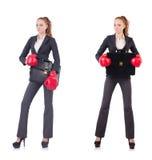 La femme d'affaires de femme avec des gants de boxe sur le blanc Images libres de droits