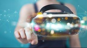 La femme d'affaires employant la technologie 3D en verre de réalité virtuelle rendent Photos libres de droits