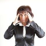 La femme d'affaires garde pour une tête Image stock