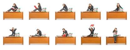 La femme d'affaires occupée d'isolement sur le blanc Photographie stock libre de droits