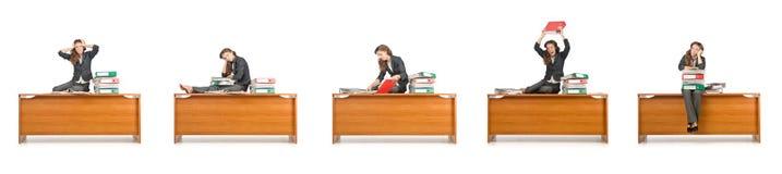 La femme d'affaires occupée d'isolement sur le blanc Photographie stock