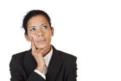 La femme d'affaires pense contemplatif sur le problème Photo stock