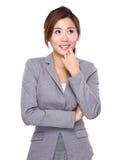 La femme d'affaires pensent à l'idée photographie stock libre de droits