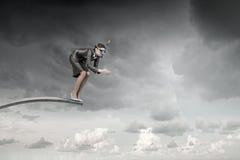 La femme d'affaires sautant dans l'eau Media mélangé Photo libre de droits