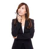 La femme d'affaires supérieure pensent à l'idée photographie stock